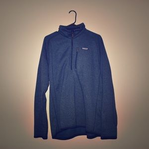 Large navy blue Patagonia half-zip pull over